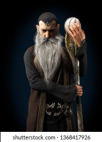 Evil Warlock old wizard posing with staff  on a dark background. 3d rendering