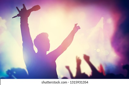 Excited singer raising hands on stage. Concert, musical gig. Entertainment, music industry. 3D illustration.
