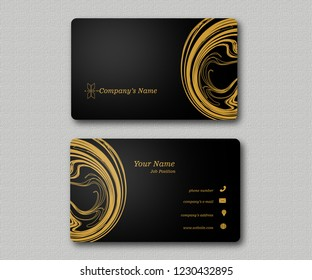 Exclusive dark business card with gold abstrack illustration