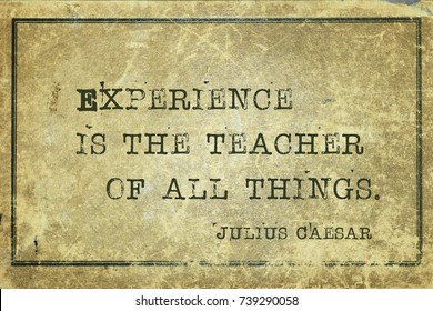 Experience is the teacher of all things - ancient Roman politician and general Julius Caesar quote printed on grunge vintage cardboard