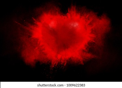 Exploding red heart on a black background