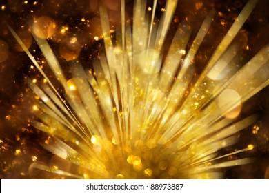 Explosion of golden lights background
