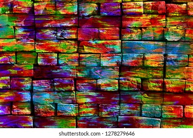 Explosion of paints. Virtual graffiti. Abstract image, drawn on a photo of a brick wall. Digital graphics by Igor Mishenev (artist-abstractionist).