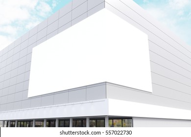Exterior of a business center with a large billboard on the corner of the building. 3d rendering. Mock up.