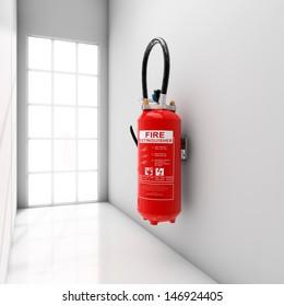 Extinguisher fixed on white corridor wall