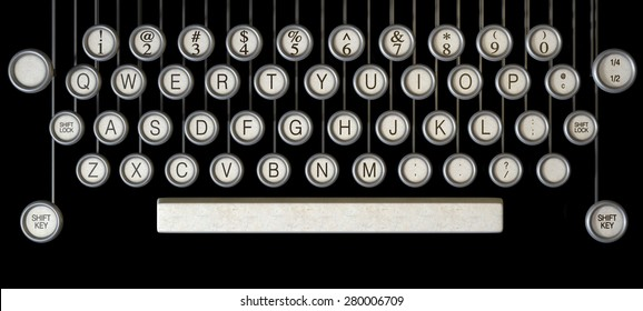 An extreme close up of the keys of a vintage typewriter on a dark background