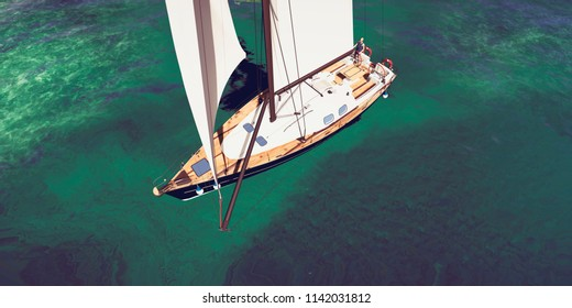 Extremely detailed and realistic 3D illustration of a sailing boat at a tropical island