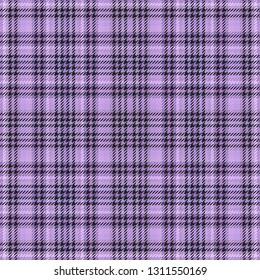 fabric plaid scottish tartan cloth pattern for background.  abstract british.