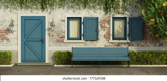 Facade with old brick wall,blue door , windows and bench - 3d rendering