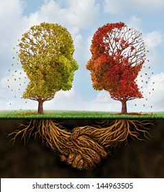 Fading team business concept as two autumn trees losing leaves in the shape of human heads with roots underground shaped as shaking hands as a team agreement that is losing strength on a summer sky.