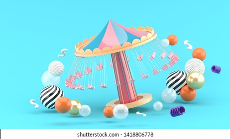 fairground rides surrounds many colorful balls on a blue background.-3d rendering.