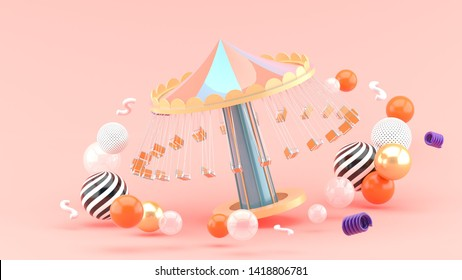 fairground rides surrounds many colorful balls on a pink background.-3d rendering.
