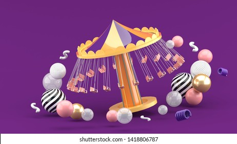 fairground rides surrounds many colorful balls on a purple background.-3d rendering.