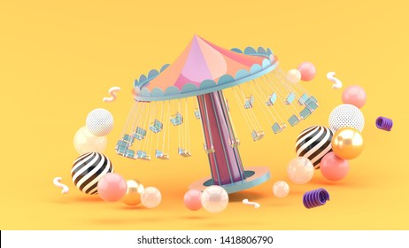 fairground rides surrounds many colorful balls on an orange background.-3d rendering.