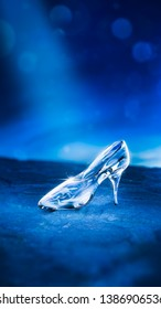 Fairy tale glass slipper shining in the moonlight. 3D illustration, rendering