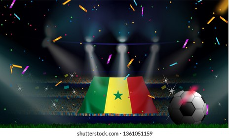 Fans hold the flag of Senegal among silhouette of crowd audience in soccer stadium with confetti to celebrate football game. Concept design for football result template