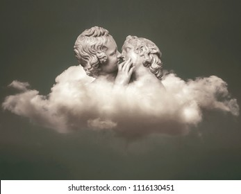Fantasy dreamy love or sensual conceptual scene depicting a young couple kissing over clouds at heaven background