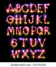 Fantasy letter A-Z from sparkler on black background