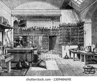 Faraday in his laboratory at the Royal Institution in London, vintage engraved illustration. From the Universe and Humanity, 1910.
