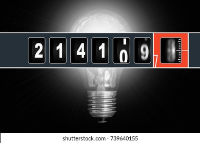 Fast running electricity meter and glowing light bulb - electricity consumption concept