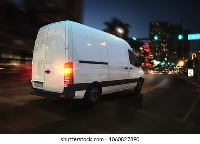 Fast van on a city road delivering at night. 3D Rendering