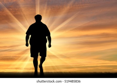 Fat man walks on nature sunset. Obesity concept