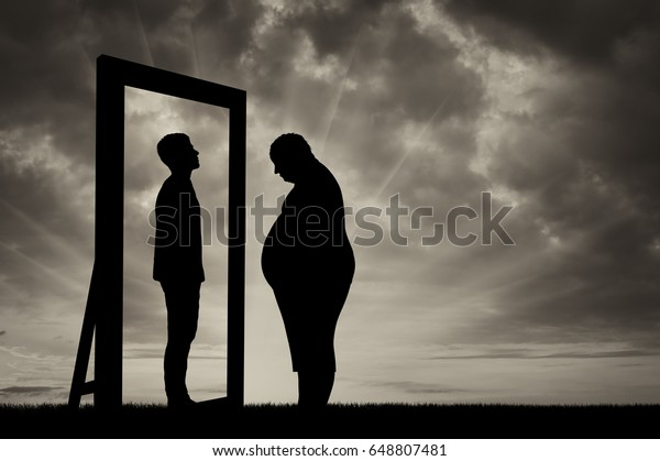 Fat sad man and his reflection in the mirror of a normal man against sky. Obesity concept