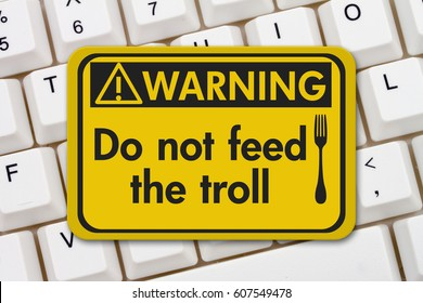 Feeding the troll warning sign, A yellow warning sign with text Do not feed the troll and fork icon on a keyboard 3D Illustration