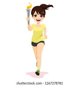 Female athlete torchbearer running holding flaming torch