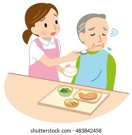 female caregiver feeding assistance to elderly the elderly don't feel like eating