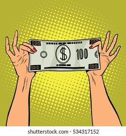 Female hands holding a hundred dollar bill, pop art retro  illustration