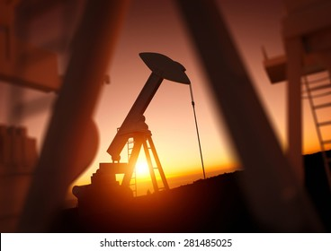 A field of oil pumps against a sunset.