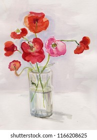 Field red poppies in a glass