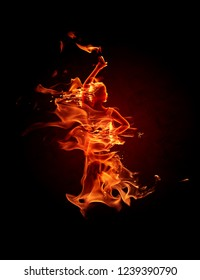 Fiery flamenco dancer. Fire flames on black background.