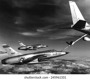 Fighters refuel over Vietnam. US Air Force F-105 Thunderchiefs refuel before their bombing mission in Vietnam. Jan. 1966.