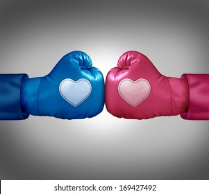 Fighting for love and relationship argument concept as blue and pink boxing gloves with heart shaped patches in a passionate couple dispute resulting in stress and possible separation or divorce.