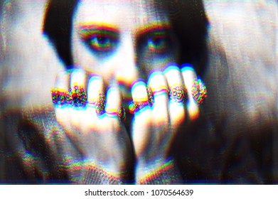 Fighting woman. Glitched portrait of a young woman illustrating the concept of  fighting against difficulty of life. Glitch art.