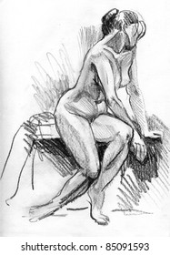 Figure of beautiful nude young woman - hand drawn sketch is made by black charcoal