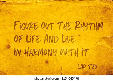 Figure out the rhythm of life and live in harmony with it - ancient Chinese philosopher Lao Tzu quote printed on grunge yellow paper