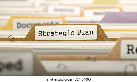 File Folder Labeled as Strategic Plan in Multicolor Archive. Closeup View. Blurred Image.