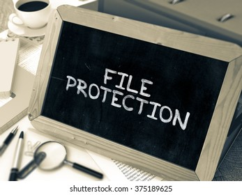 File Protection Handwritten on Chalkboard. Composition with Small Chalkboard on Background of Working Table with Ring Binders, Office Supplies, Reports. Blurred Background. Toned Image. 3D Render.