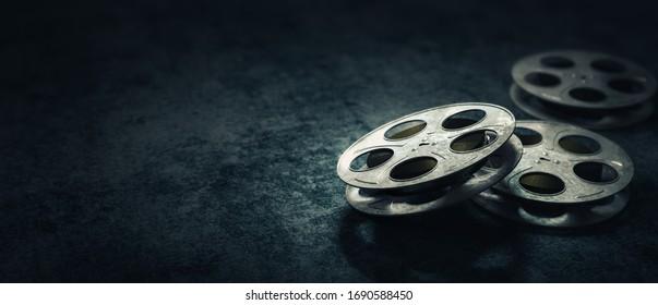 Film reels on a dark blue background / 3D rendering, illustration