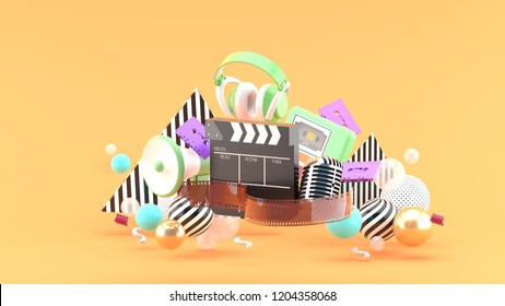 Filmstrip and clapper movies and entertainment on orange blackground.-3d rendering.