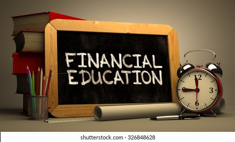 Financial Education Handwritten by white Chalk on a Blackboard. Composition with Small Chalkboard and Stack of Books, Alarm Clock and Rolls of Paper on Blurred Background. Toned Image.