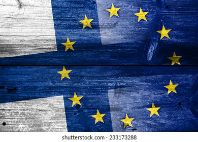 Finland and European Union Flag painted on old wood plank texture