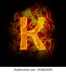 Fire burning letter K, alphabet, hot yellow orange design element on black background