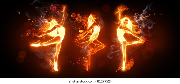 fire dancers on the black background