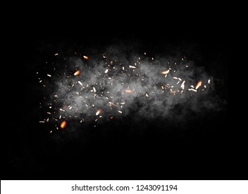 Fire particle . Embers debris on isolated black background. Smoke on background texture.
