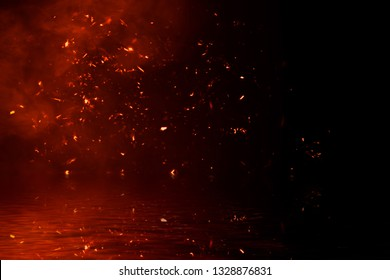 Fire particles embers with reflection in water. Design texture for banner,flyer,card and poster .