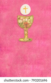 First Holy Communion card. Gold chalice with flowers  and host on pink background with copy space, vertical image.